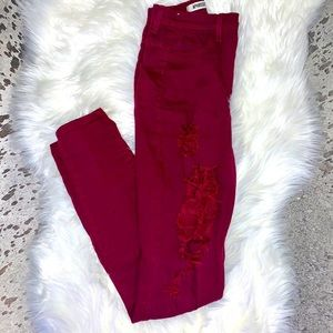 burgundy high rise distressed jeans